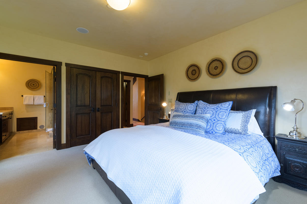 Guest Bedroom 2 features a king-size bed and has an attached ensuite bathroom.