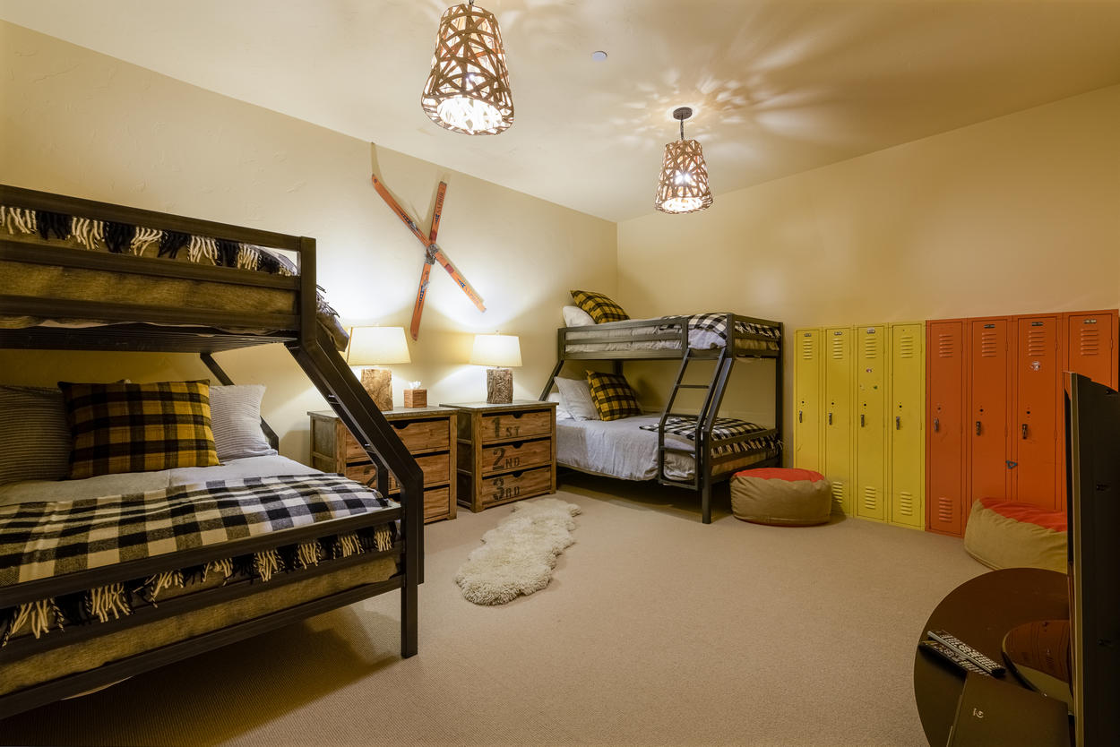 The Bunk Bedroom features two captain's bunks, which each have a full on bottom and twin on top.