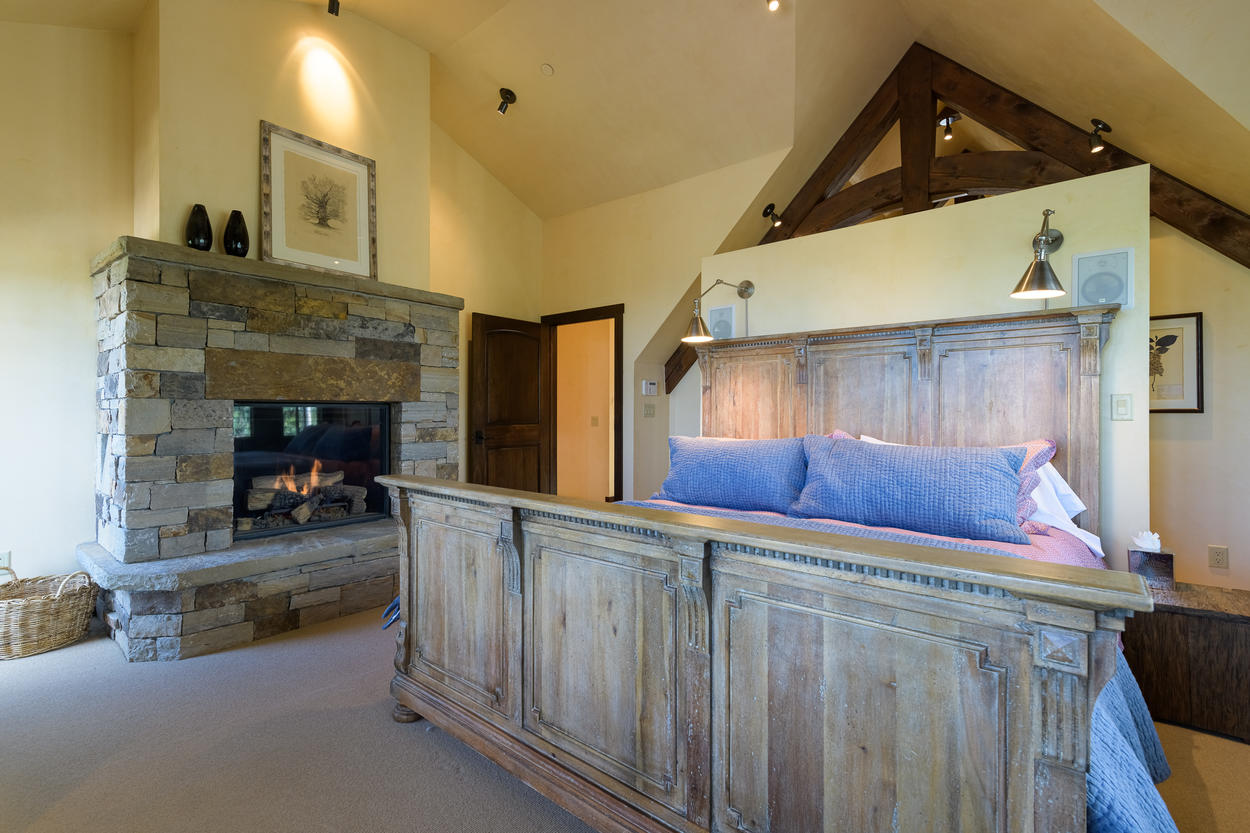 The Master Suite occupies the full top floor and has an exquisite king size bed and a large, stone gas fireplace.