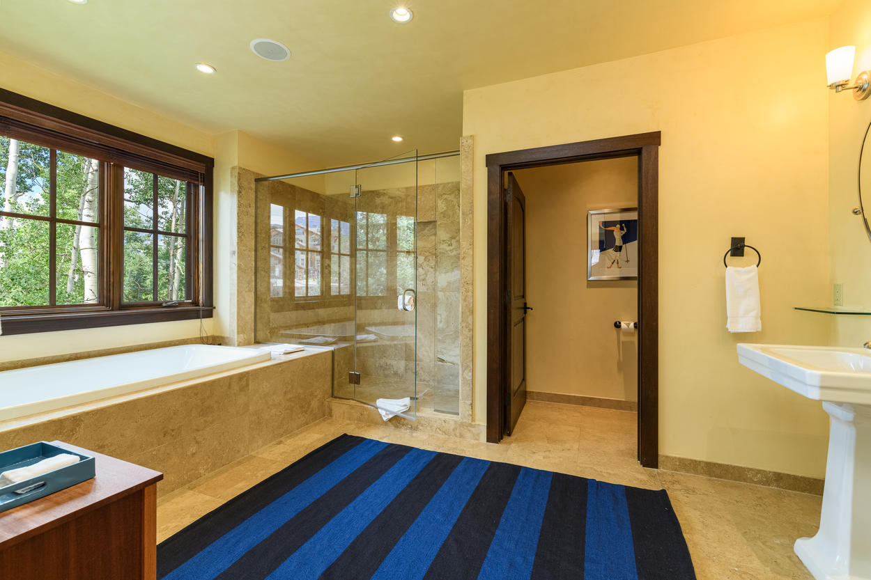 Enjoy a soak in the large bathtub, or relax in the oversize walk-in shower.