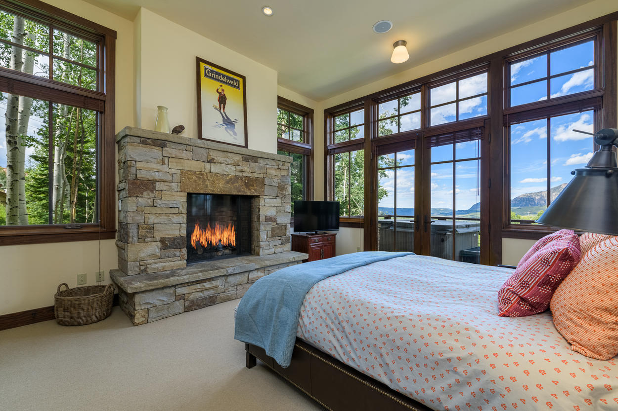 Guest bedroom 3, located on the second floor, has a queen-size bed, gas fireplace, and access to the private hot tub.
