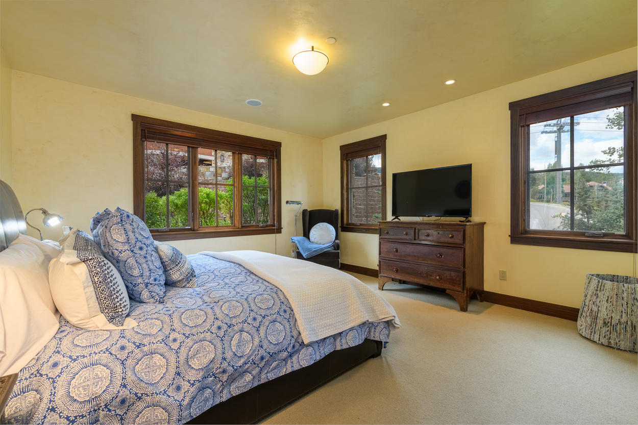 Guest Bedroom 2 is located on the third floor and features a king bed and flat screen TV.