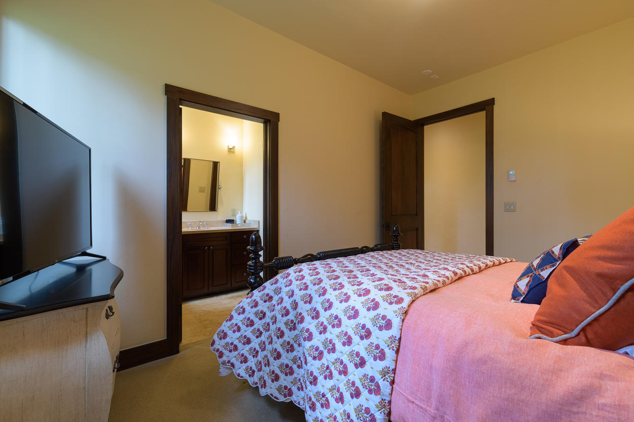 Guest Bedroom 4 has its own attached ensuite bathroom and a large flat screen TV.