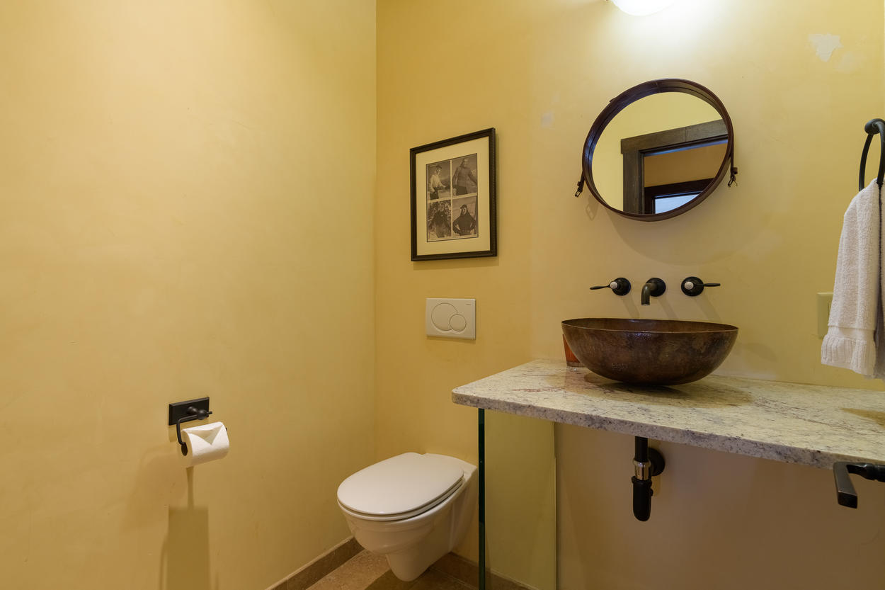 There's a convenient powder room located on the main third floor with a single sink.