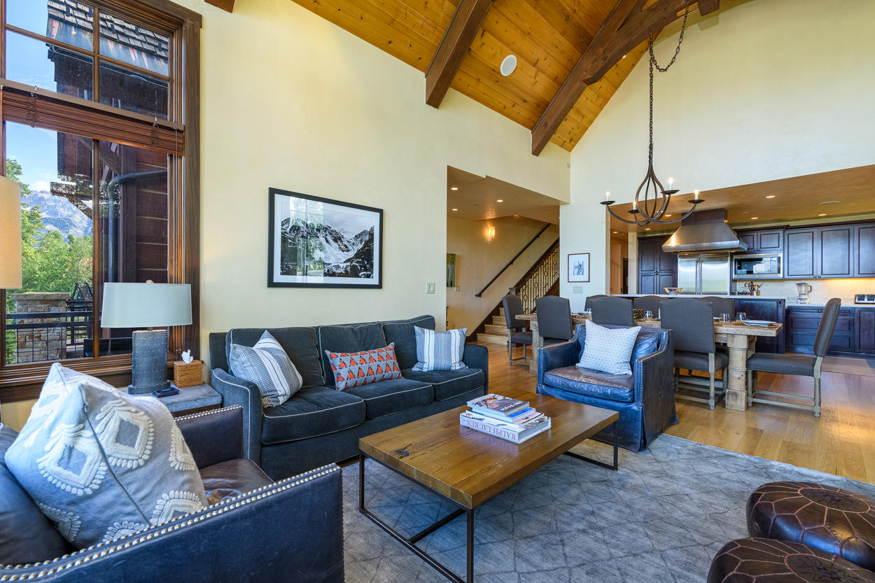 The main living area features an open-concept design with vaulted wood ceilings.