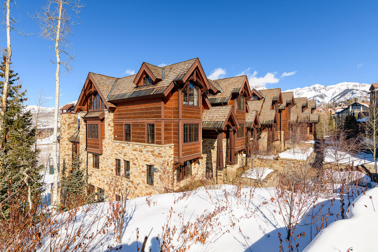 This corner residence towers above Mountain Village just a short walk from the Core.