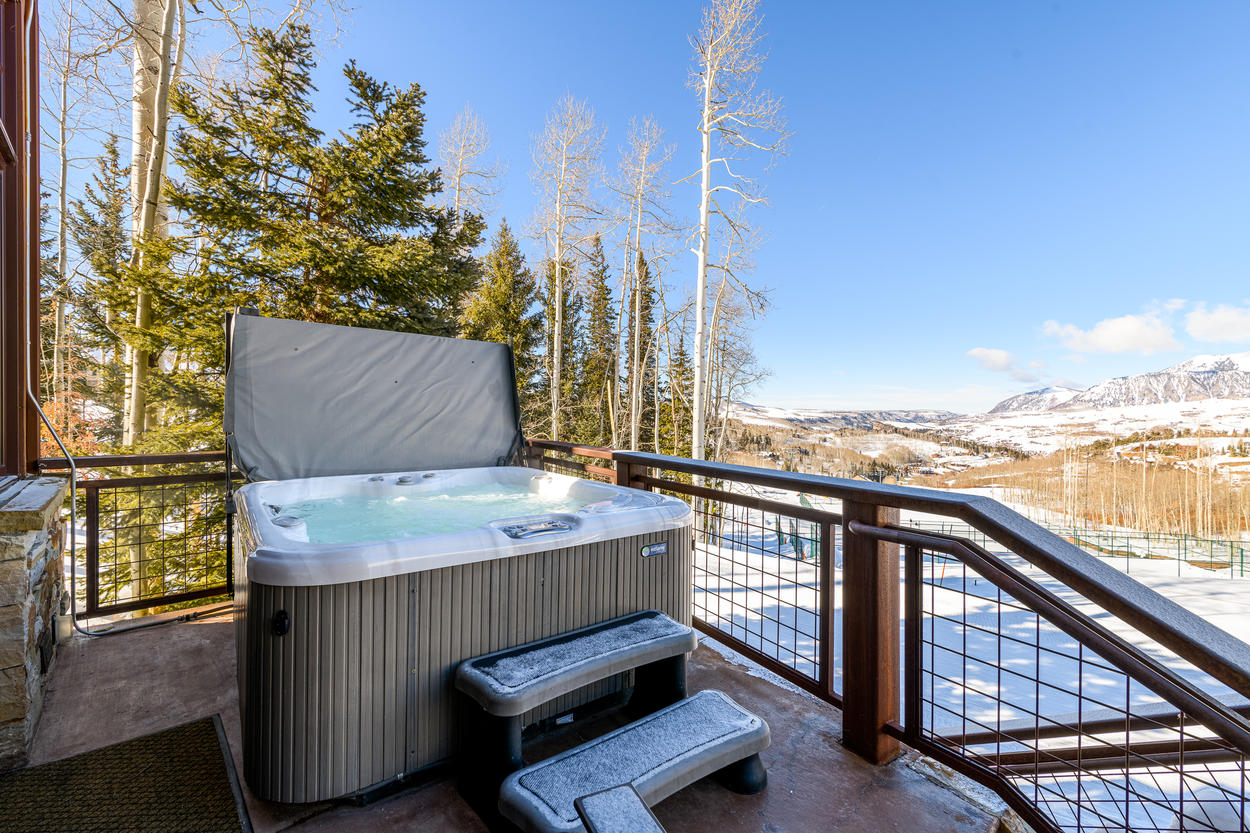 The hot tub is located on the back deck of the second floor, and overlooks the valley.