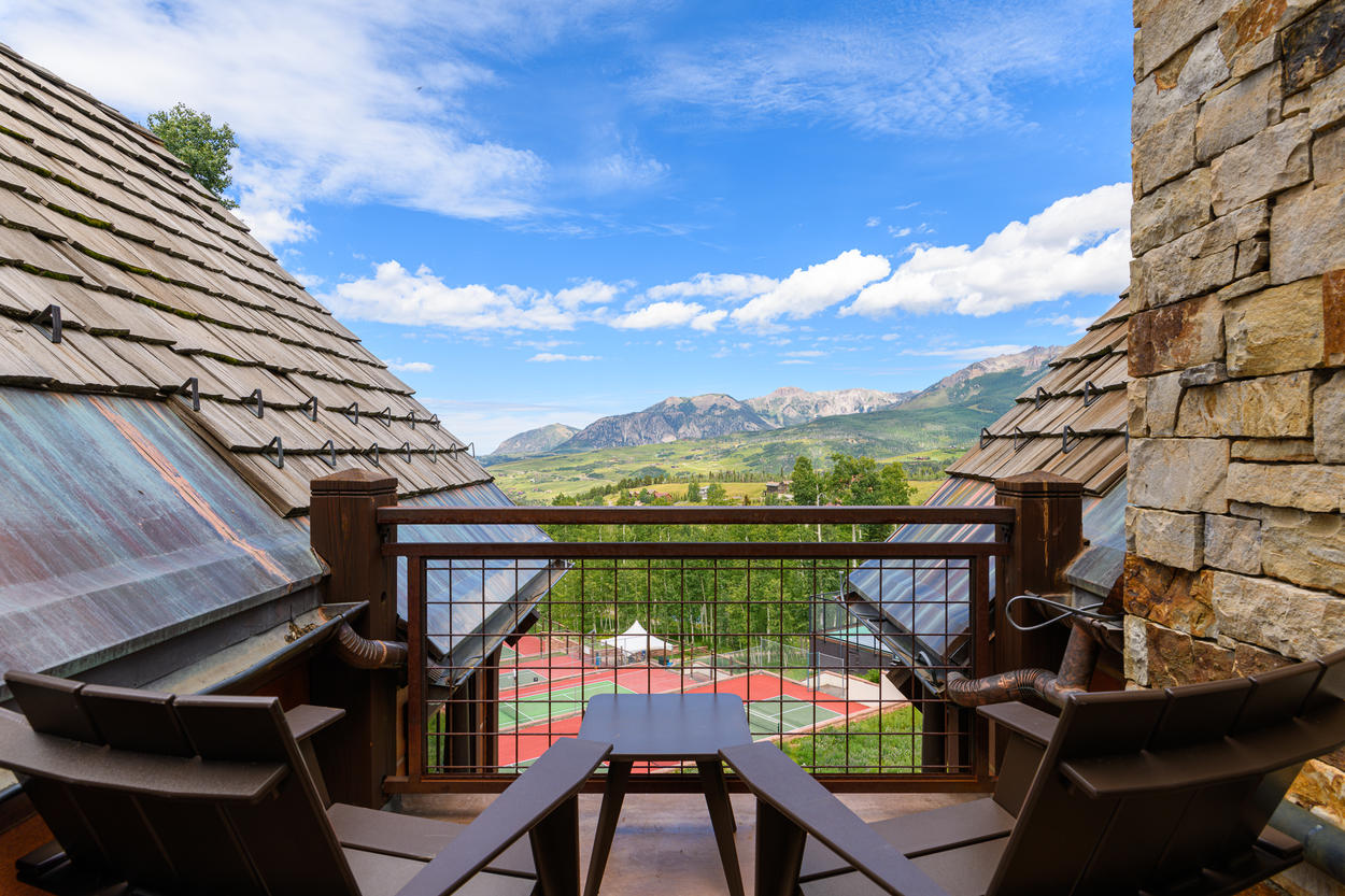 The fourth floor balcony has seating for two to go with those mountain views.