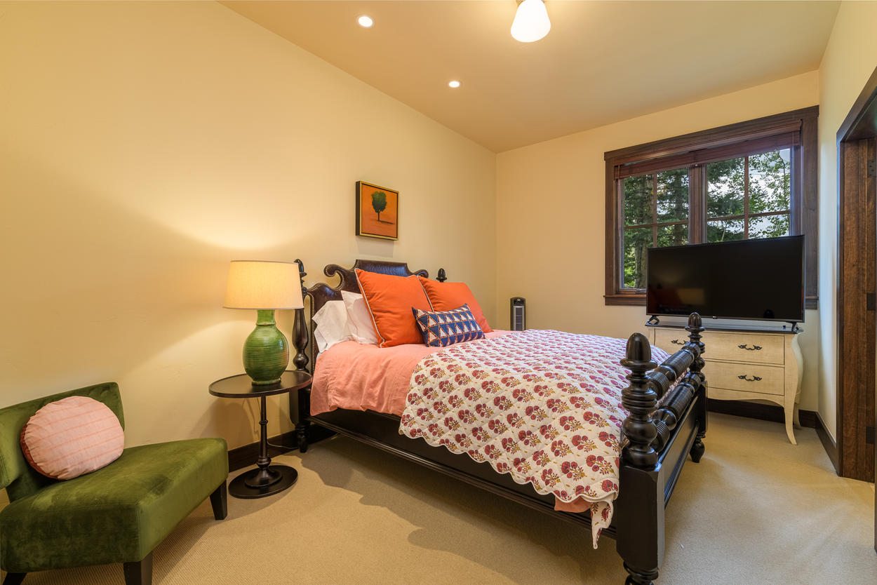 Guest Bedroom 4 is located on the second floor and has a queen-size bed, TV, and ensuite bathroom.