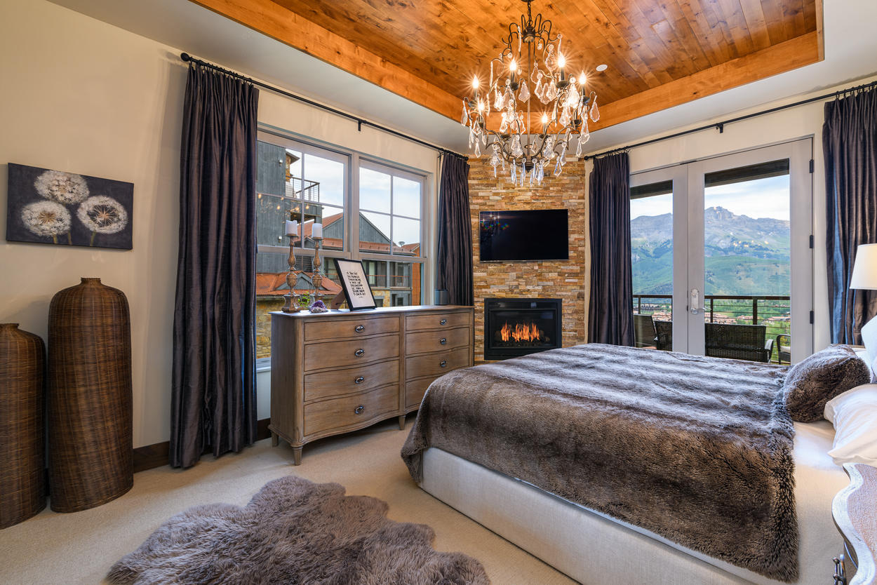 The Master Bedroom has its own gas fireplace and mounted TV.