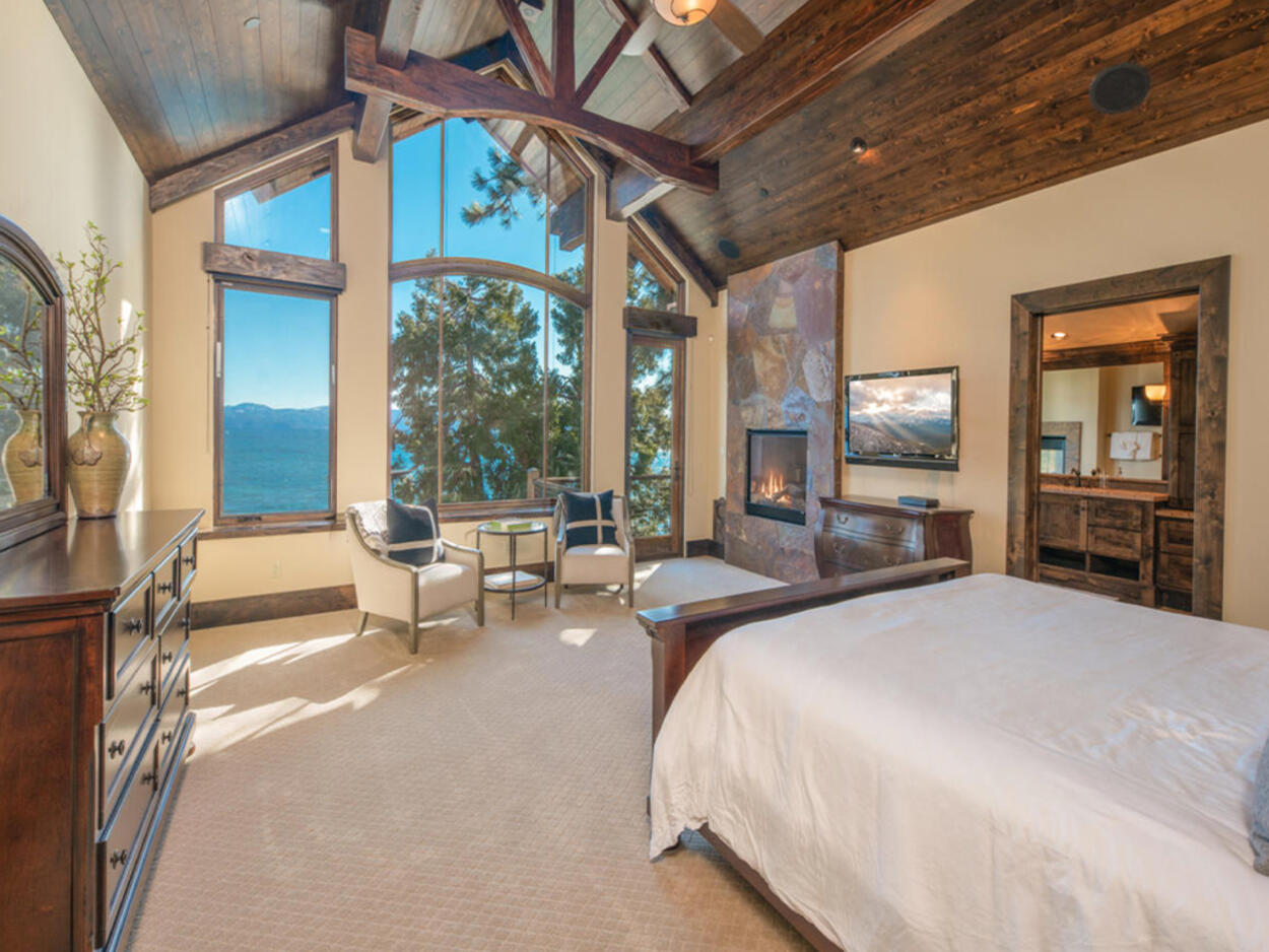The Master bedroom on the top level offers amazing lake views.