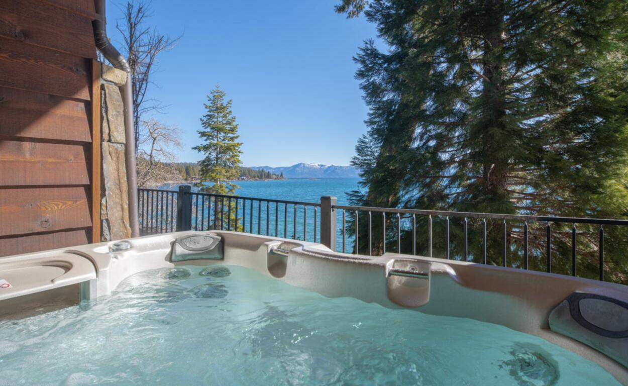 The private hot tub offers a relaxing soak with great views of Lake Tahoe and distant mountain range.