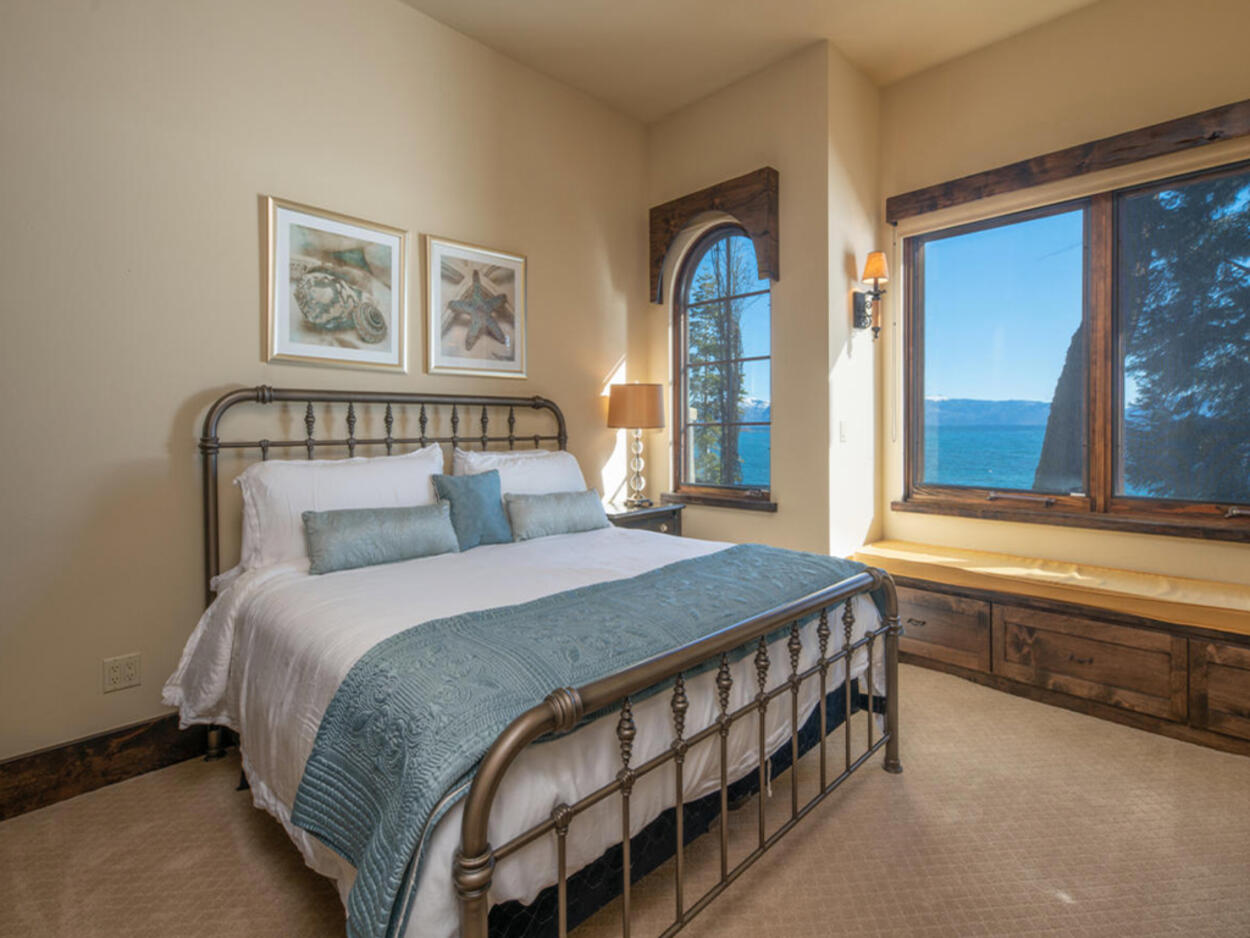 The fourth bedroom comes with a queen-size bed and attached ensuite.