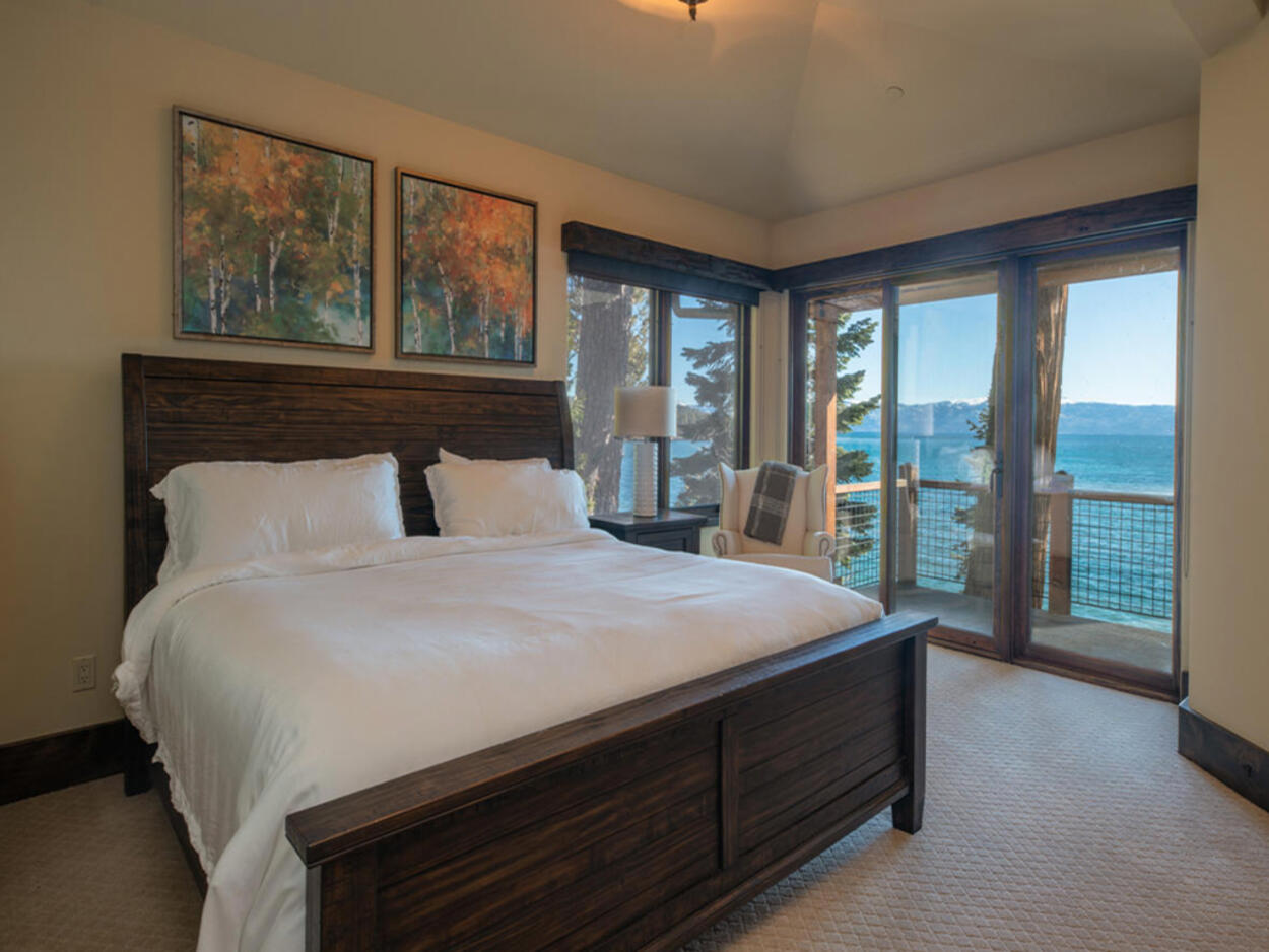 On the main level, the second guest bedroom comes with a king-size bed.