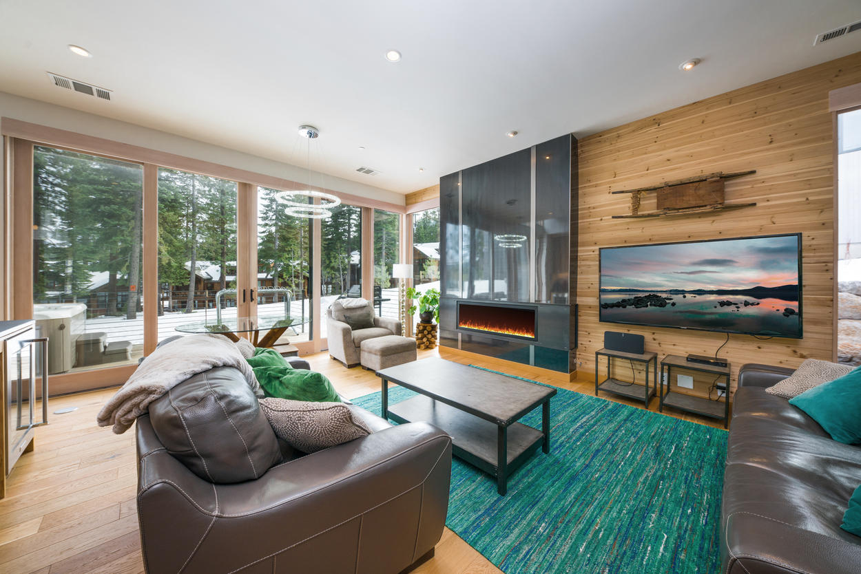 The spacious living area has amazing views through the floor-to-ceiling windows.