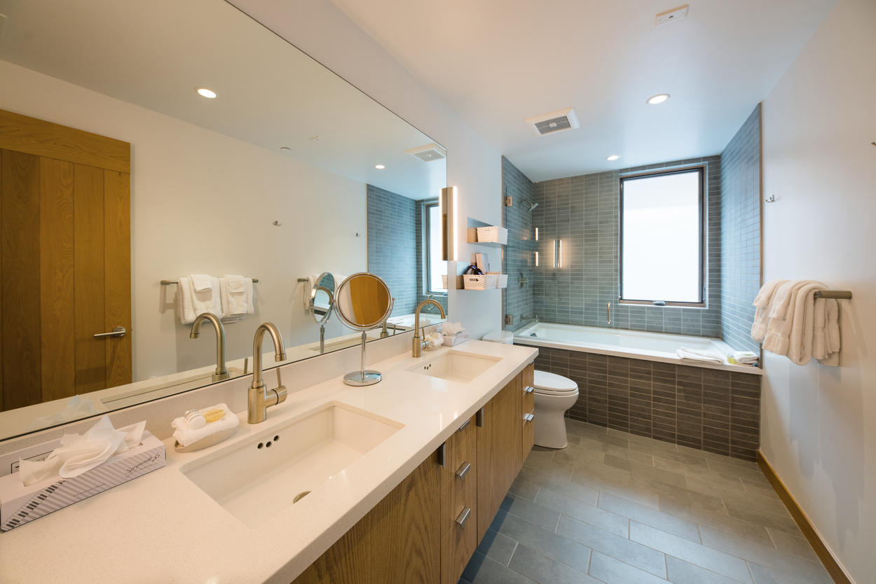 In the master bathroom, you'll find a spacious dual vanity and shower/tub combo.
