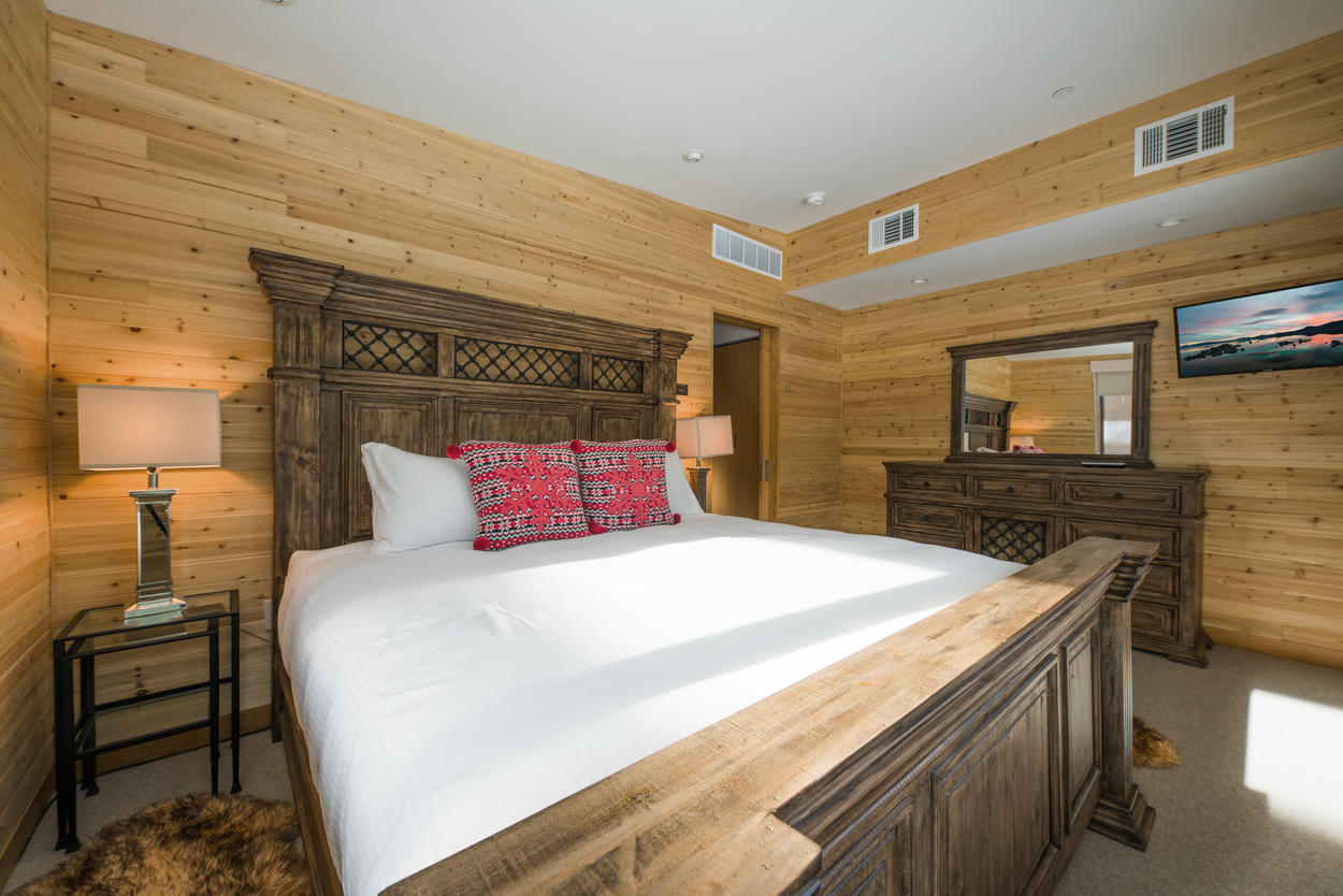 The second guest bedroom comes with a California king and a TV as well.
