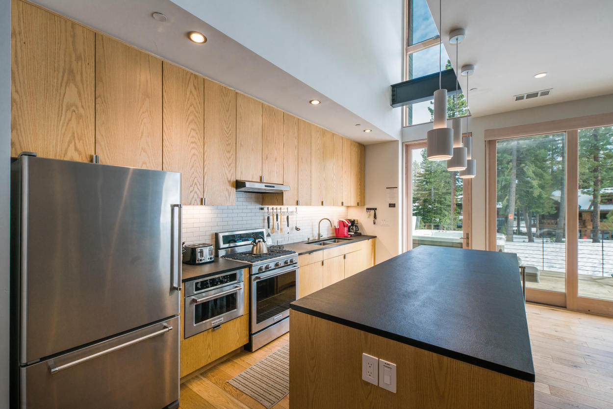 The adjacent modern kitchen is nearby, should you want to fix yourself a quick snack.