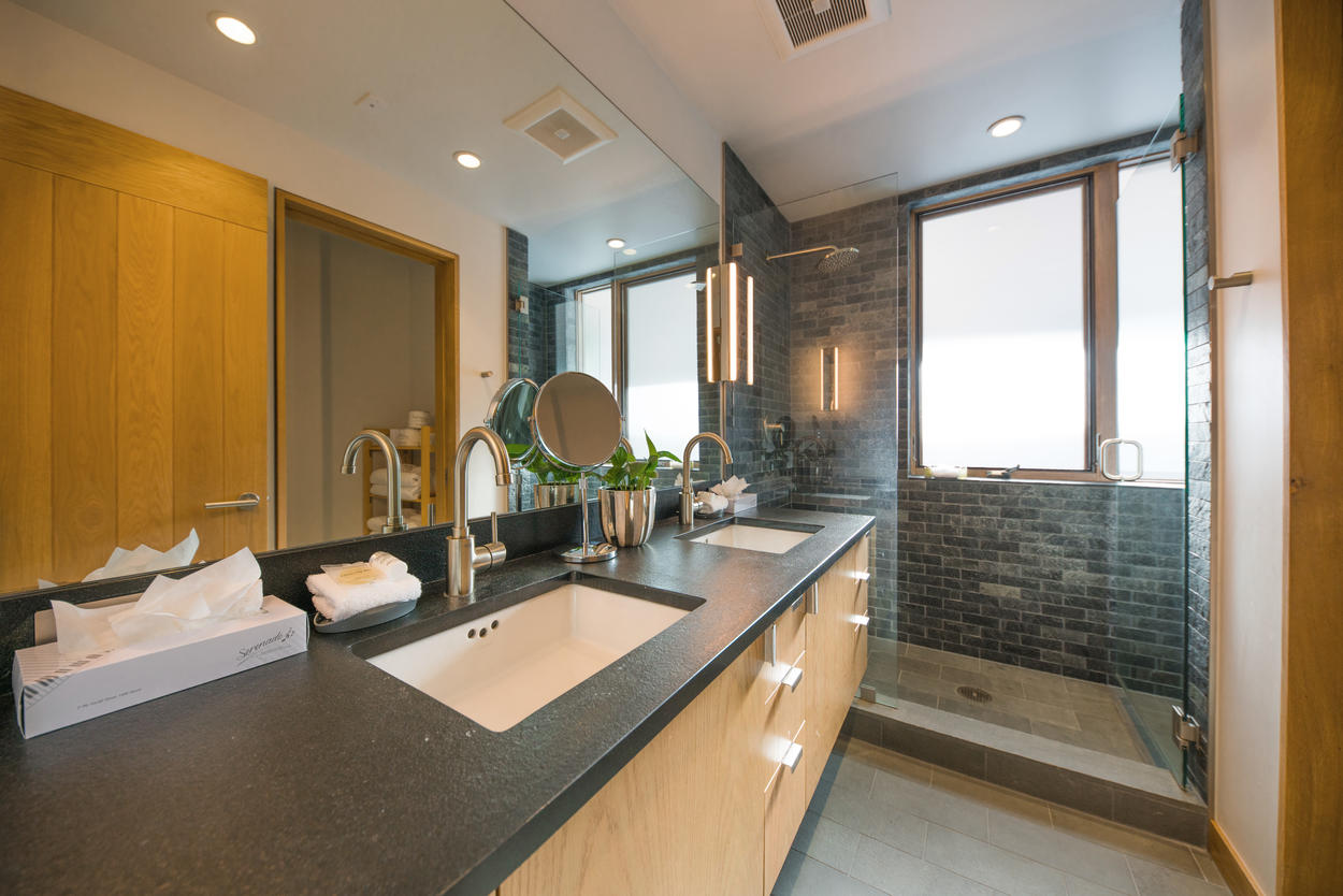 The full guest bathroom has dual sinks as well as a large walk-in shower.