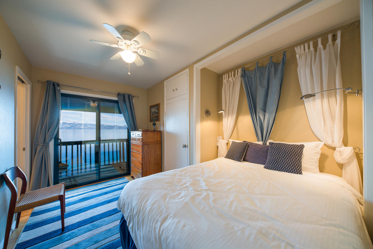 The queen guest room has upper balcony access with stunning views of the lake and mountains.