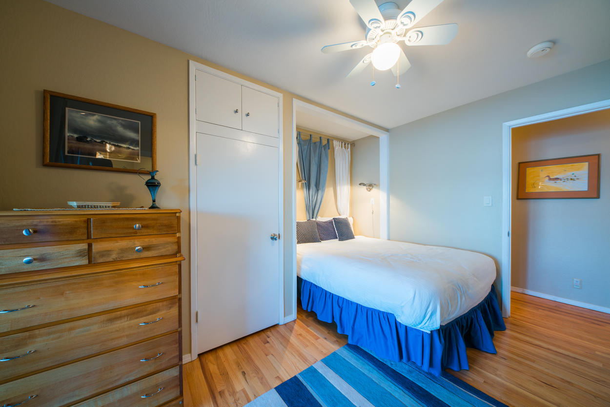 A queen-size bed fits snug into a nook in the guest room, and has an attached ensuite bathroom.