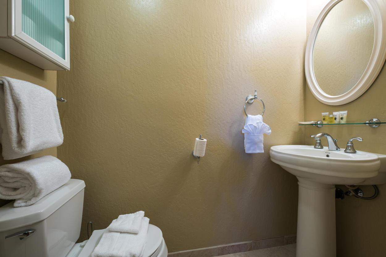 The second floor has a convenient hallway half bath powder room.