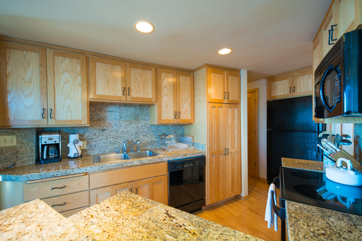 The kitchen has ample working space on the granite countertops.