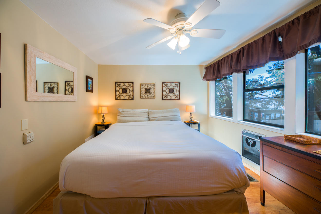 The Master Bedroom on the first floor has a king-size bed and dresser.