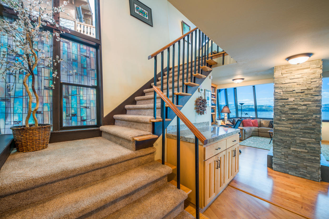 Take the staircase to reach the second floor and additional bedrooms.