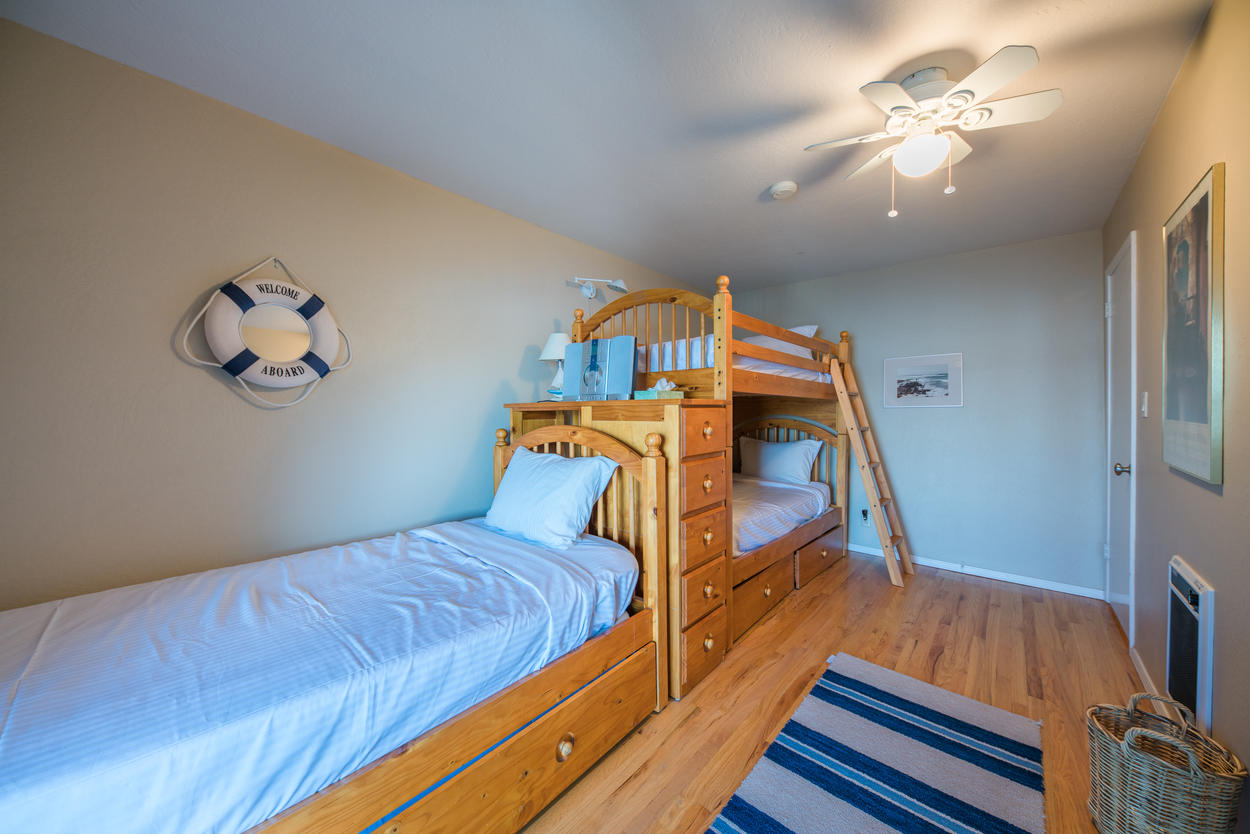 The bunk room has a twin bunk set with an additional twin bed with a trundle, which altogether sleeps 4.
