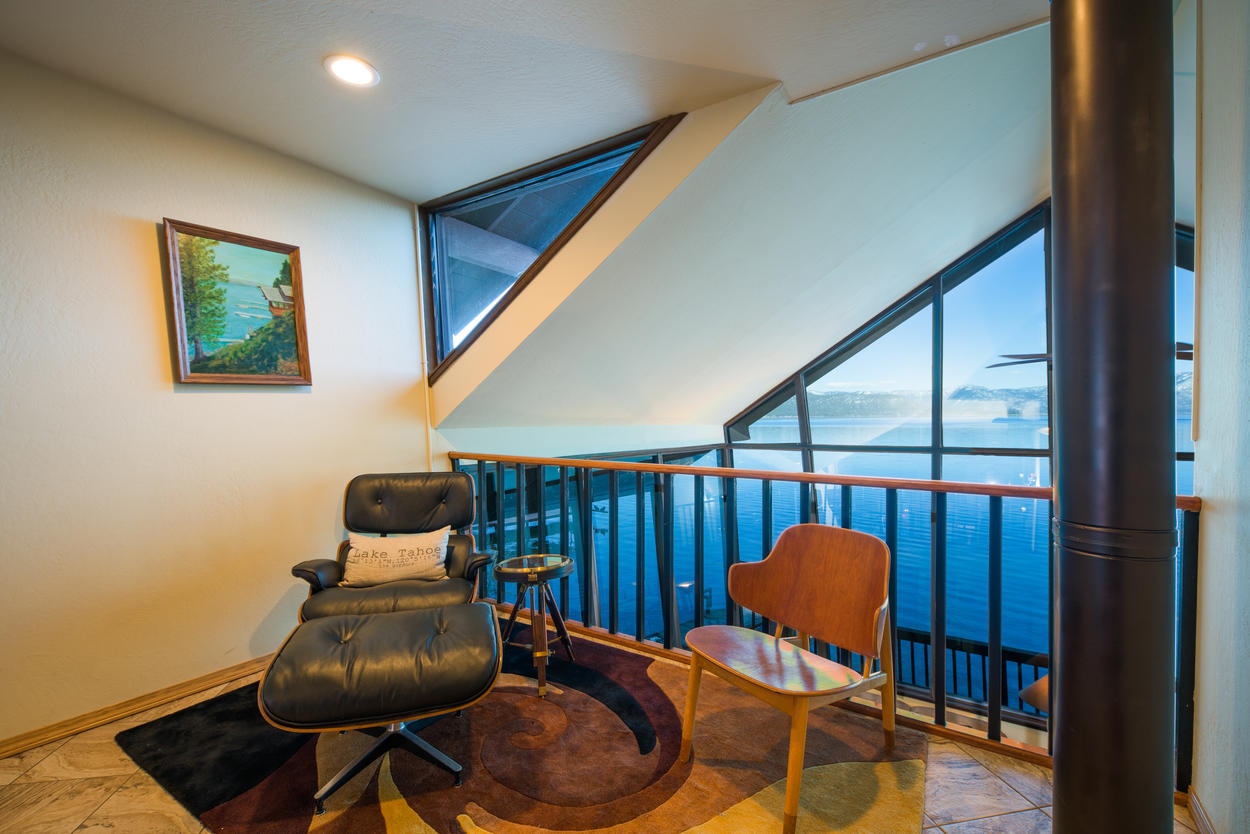 On the second floor, relax in the loft and observe the stellar views out onto the lake.
