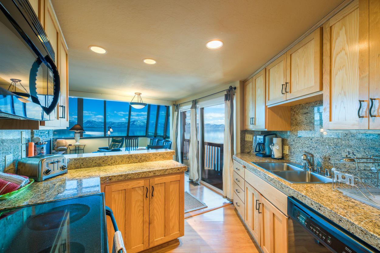 The full kitchen includes an electric stove, dishwasher, refrigerator, and more.