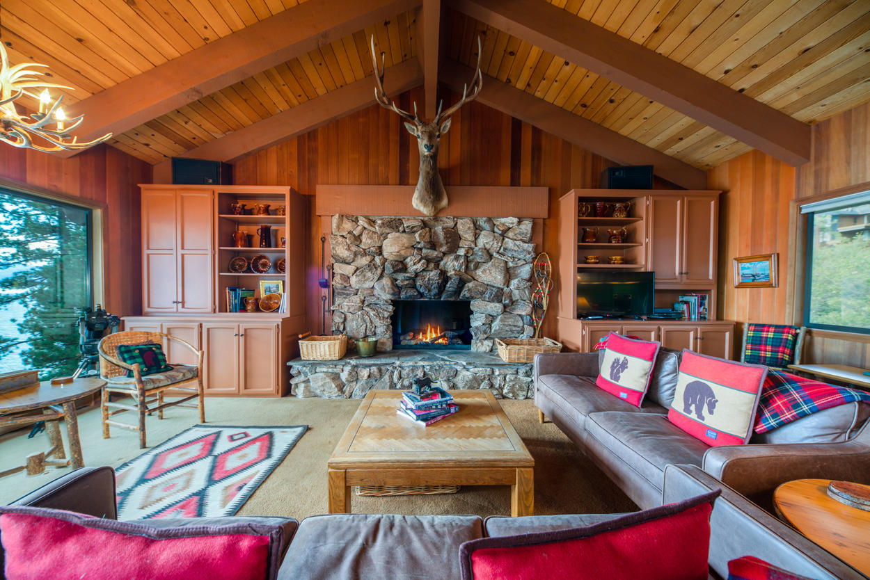 Relax in this spacious living room after a day on the slopes to watch the snow fall outside