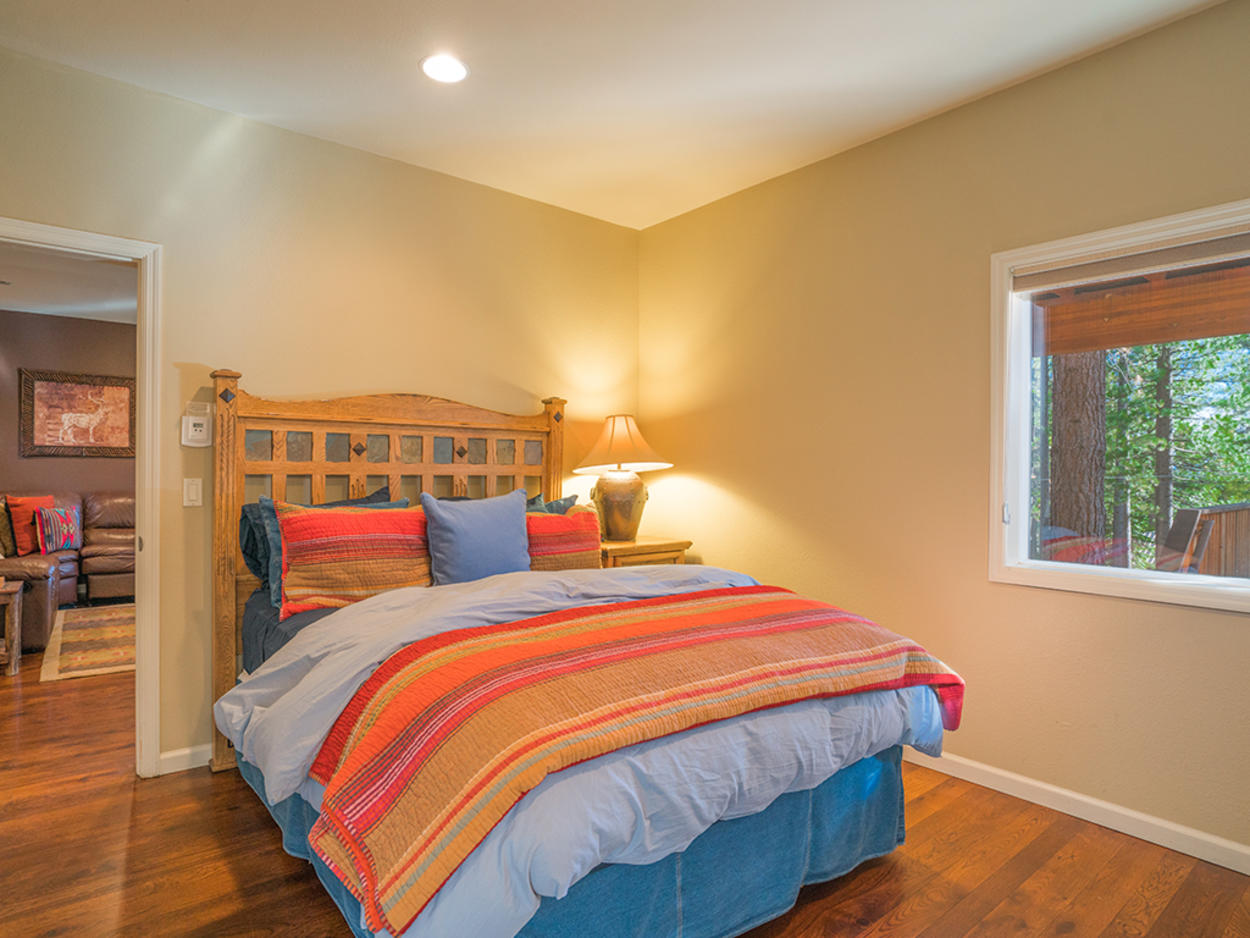 Guest Bedroom 3 receives plenty of natural light through its picture window.