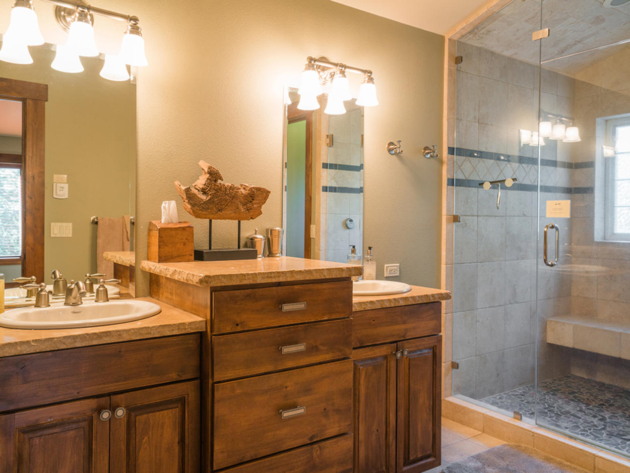 A double vanity topped with stone makes getting ready in the Master ensuite a breeze after warming up in the walk-in steam shower.