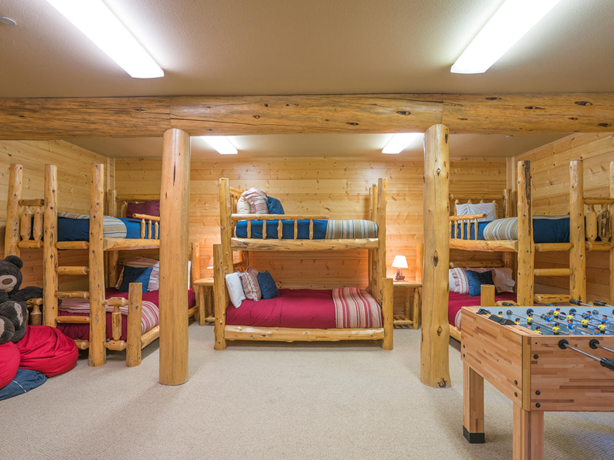 The bunk room on the lower level features 3 captains bunks (twin over full) and accommodates up to 9 guests comfortably.