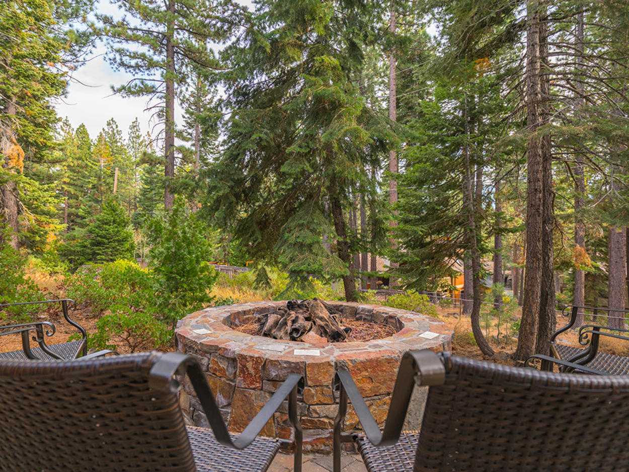 Cozy up by the fire pit on a starlit night.