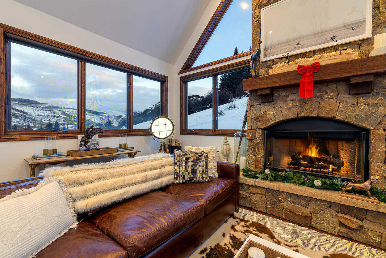 Enjoy the views and the fireplace in one of the many living spaces