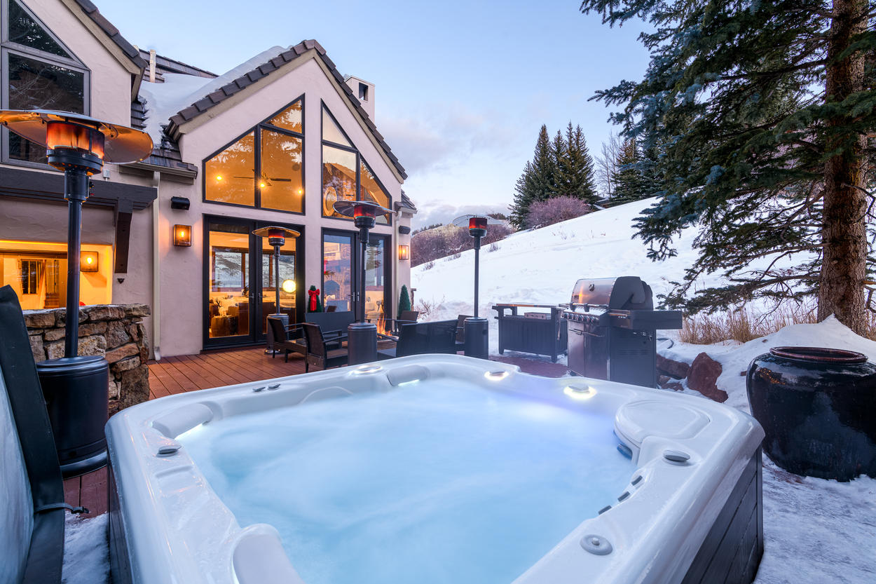 You just might not be able to resist getting the fire pit, hot tub, or heated lamps going.