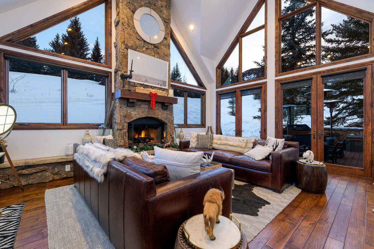 The warmth continues inside with the home's big gas fireplace, and there's plenty of seating for all to gather around it.