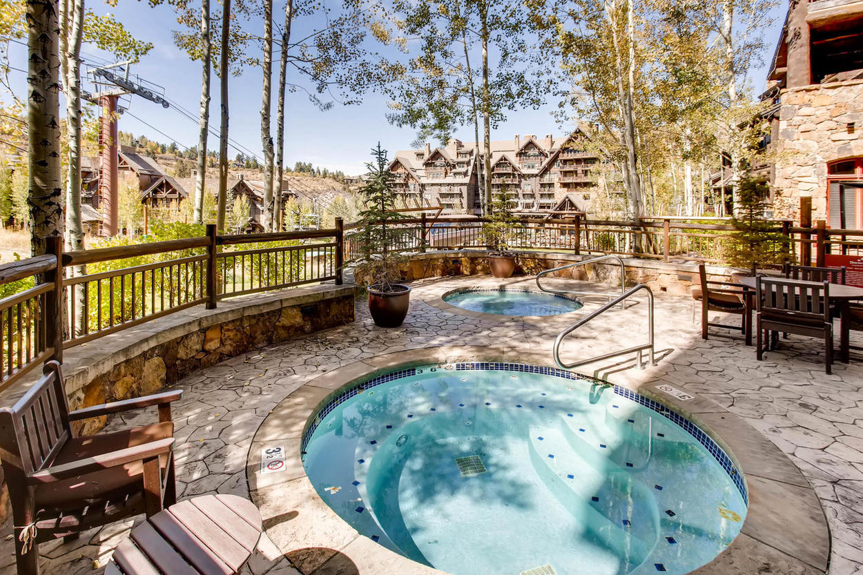 Rejuvenate in the shared outdoor hot tubs at Snowcloud after a long day of skiing.