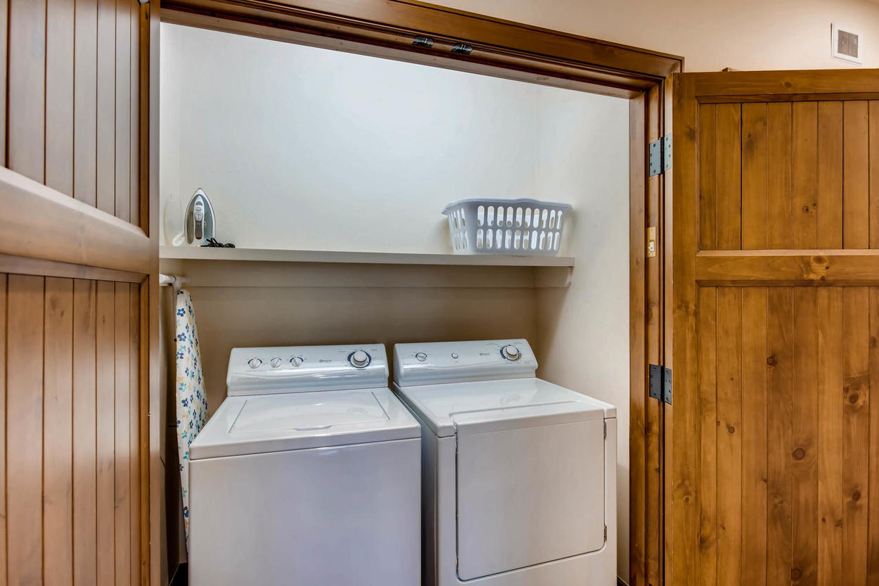 A laundry closet makes it convenient to keep your ski gear fresh.