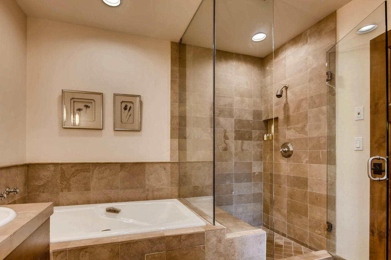 Enjoy the Master Bedroom's ensuite bathroom, with a walk-in shower and relaxing tub.
