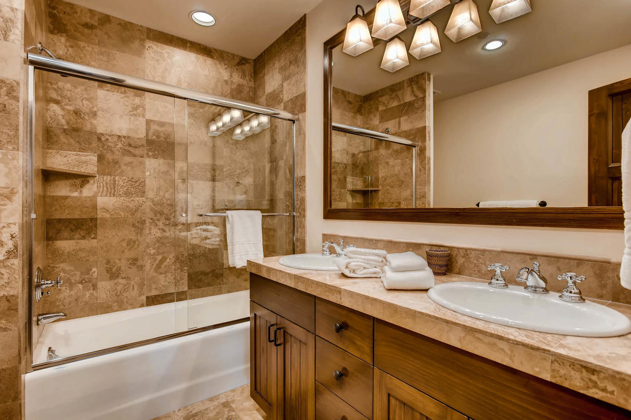 Get ready for the day surrounded by the calming, natural tones of the ensuite bathroom.