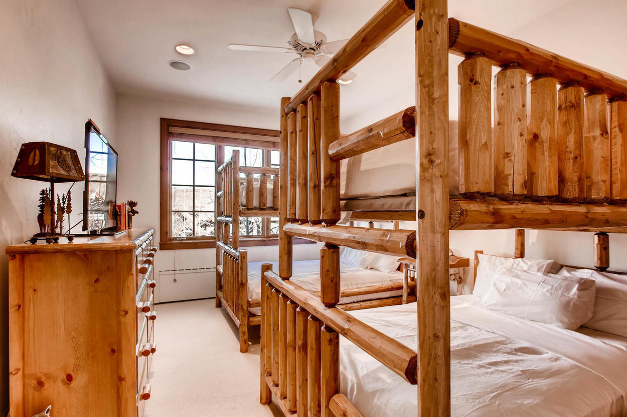 The rustic bunk room has two full/twin bunks for teens or adults.