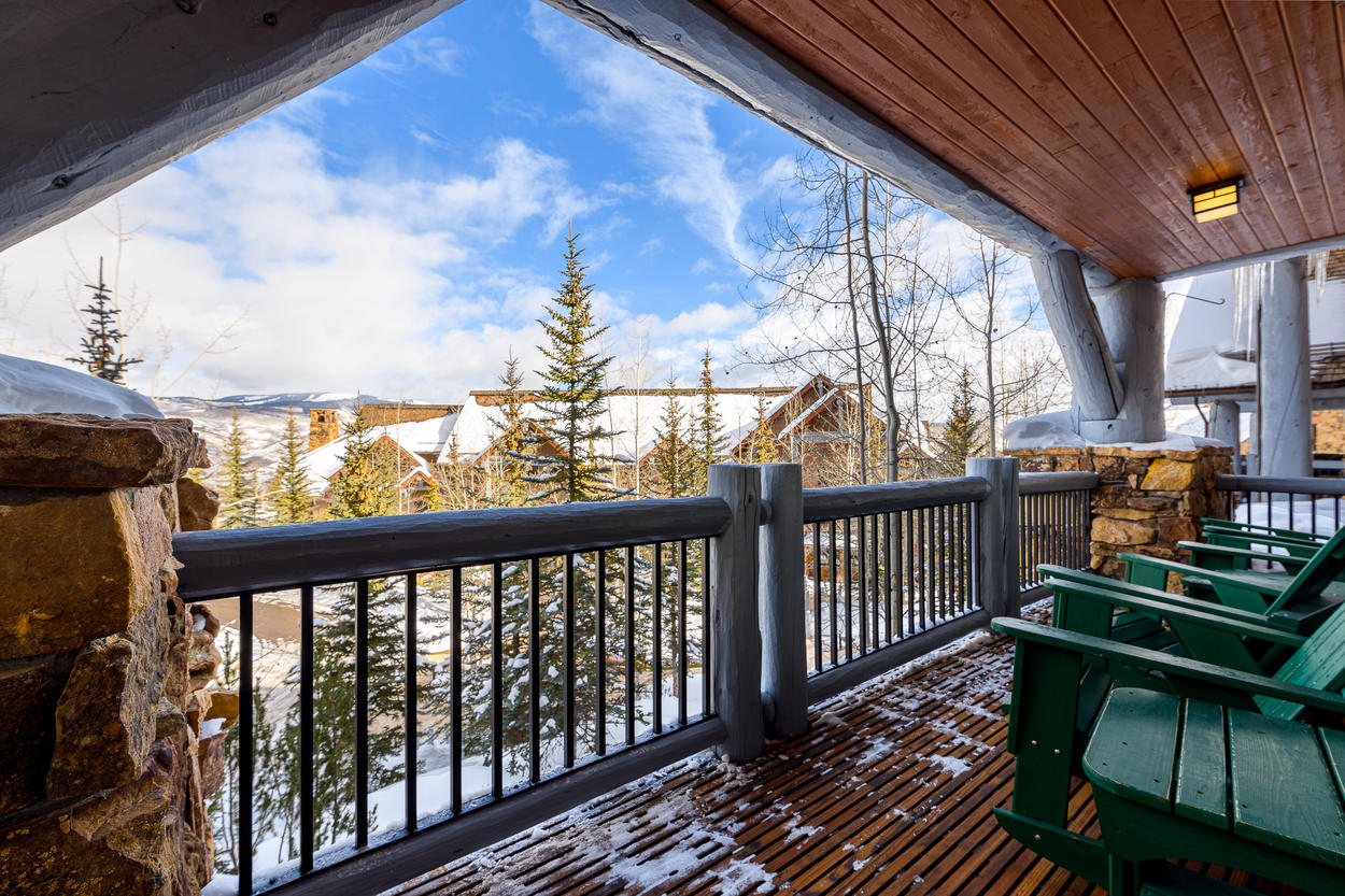 The covered balcony is the perfect spot for morning coffee, or apres ski.