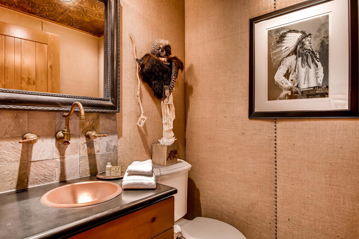 The powder room has a distinct Southwest flavor that fits well with the rest of the home.