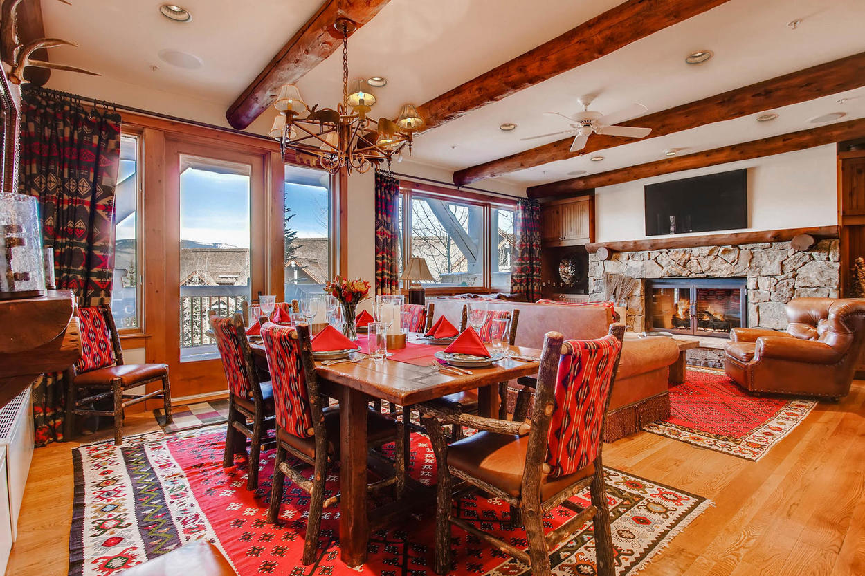 The dining table has seating for six and incredible views of the mountains.