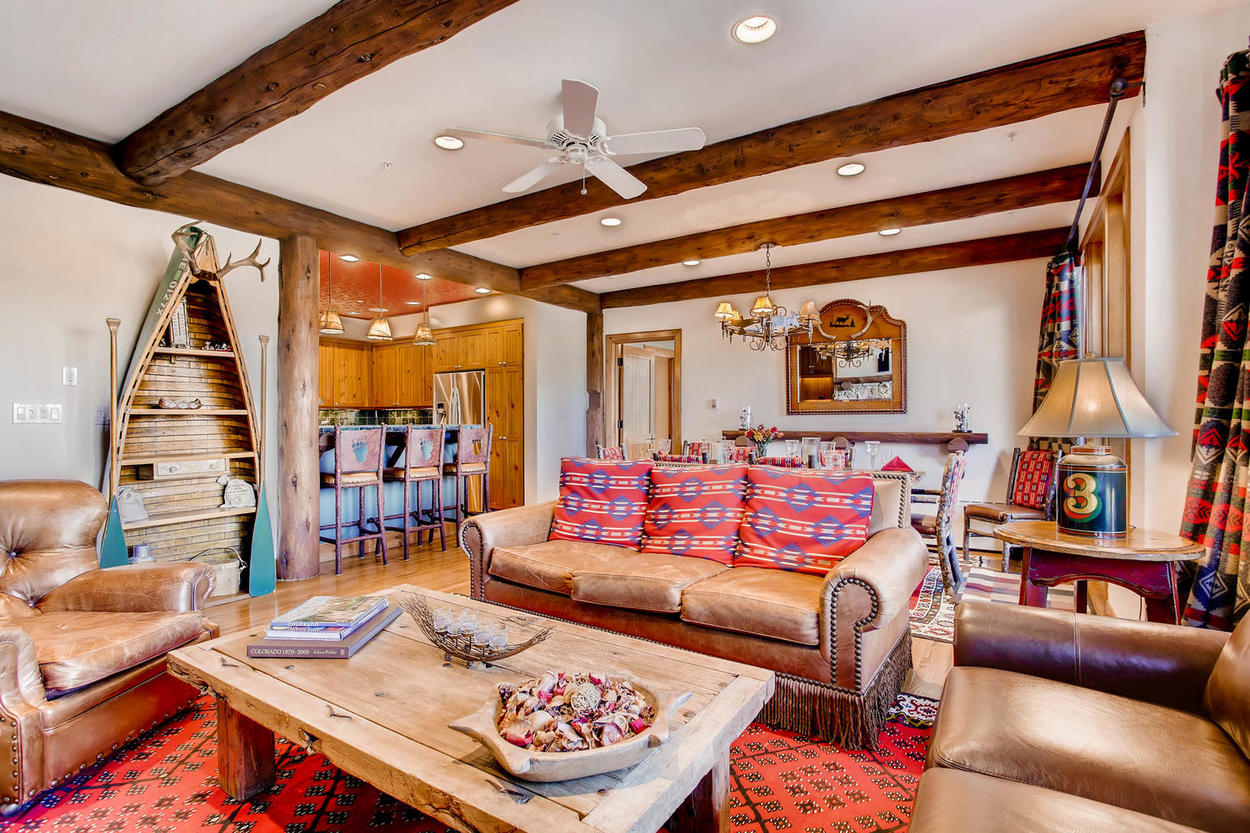 The cozy living area has plenty of seating around the gas fireplace.