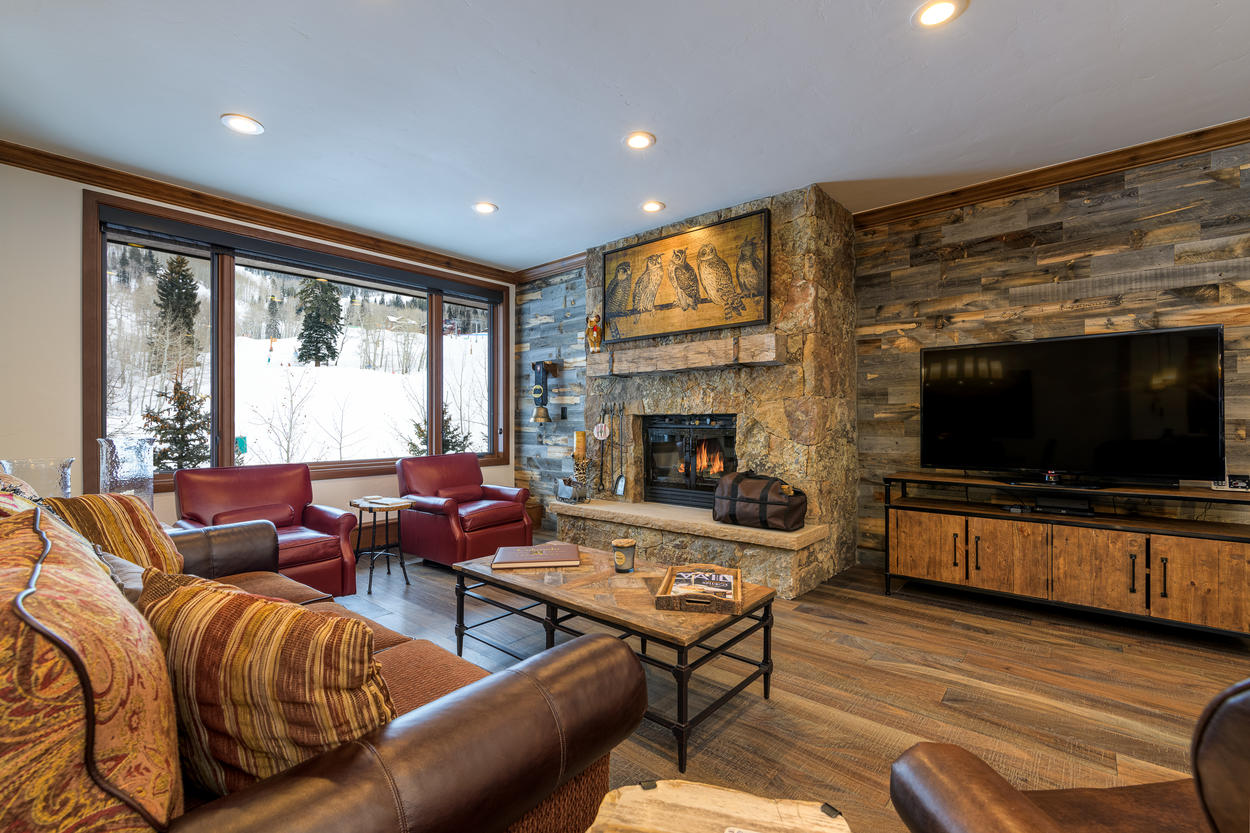The grand fireplace and large TV in the living area is a great backdrop for gathering with your entire group.